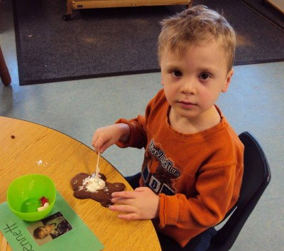 Bennett loves fun school activities like cookie decorating.