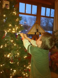 Bennett hangs an ornament!