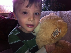 Bennett cuddles the bear he was given by a Calgary Hitmen player during a visit to Alberta Children's Hospital.