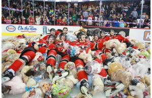 Calgary Hitmen surrounded by teddy bears on the ice. Photo by Gavin Young, Calgary Herald.