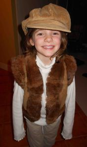 Little orphan Avery rocks her $10.99 rabbit fur vest.