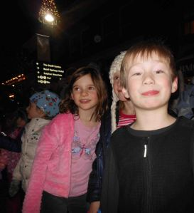 Avery and two friends wait for Santa (and more candy canes).
