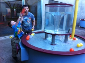 Bennett loved throwing balls into this water whirlpool.