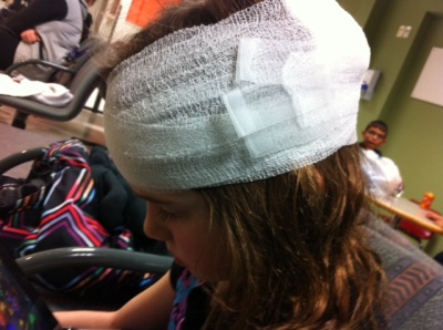 Bandaged in triage, my daughter's head injury killed what might have been a romantic night out. Nevermind, hobbits  kinda kill romance too.