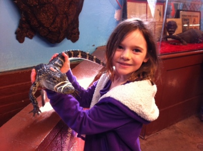 Avery holds an alligator.