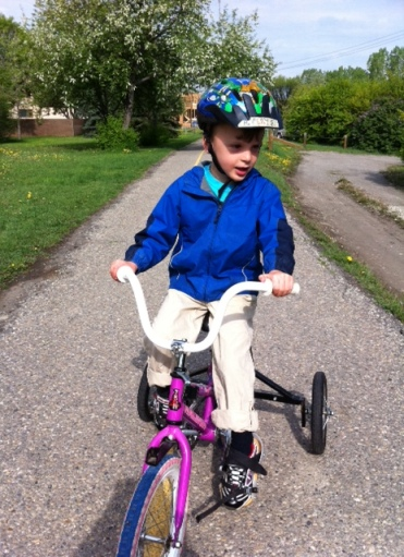 I love this adapted bike from Renfrew -- makes it a lot easier to learn to ride. At Nellie Breen park in Inglewood.