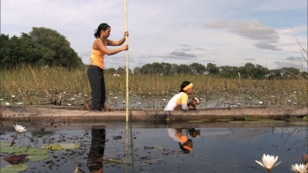 Exploring the Okavango Delta, Botswana by dugout canoe.