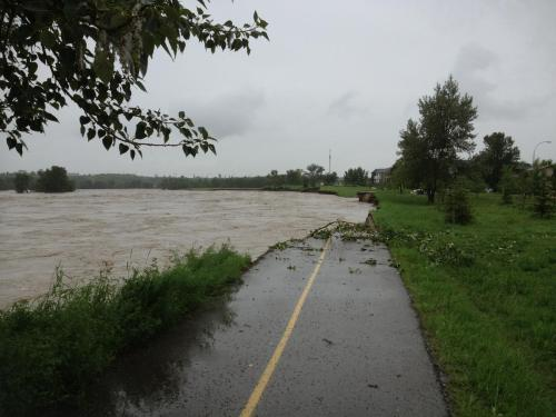 Pathway to nowhere but trouble as the Bow River ate through metres of riverbank in Inglewood on a soggy Friday.