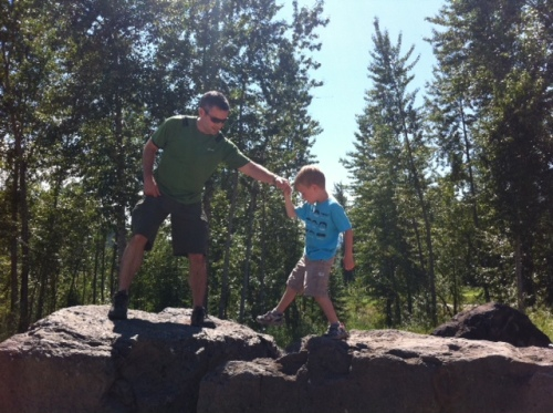 Blake helps Bennett with some rock hopping on part of the the Coal Creek Heritage Trail in Fernie, B.C.