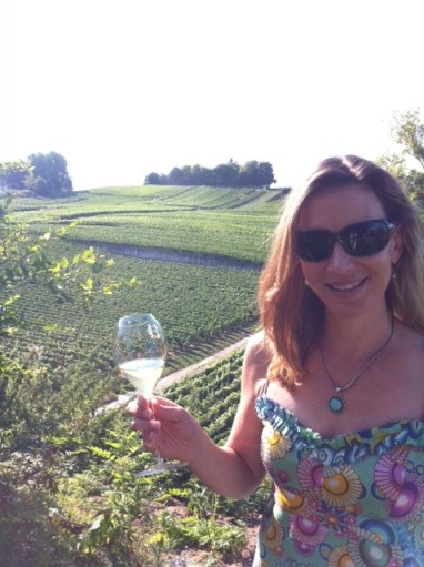 The newly-minted chatelaine sips champagne at a vineyard in Champagne.