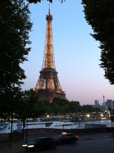 The Eiffel Tower is lit up at night and even sparkles for five minutes every hour.
