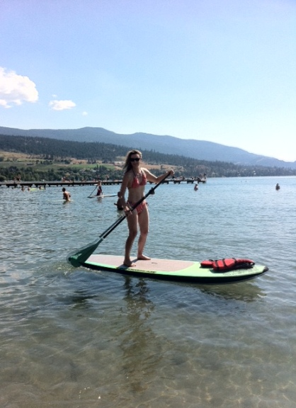 Stand up paddle boarding really is as easy as it looks. At Kalamalka Lake, Okanagan Valley.