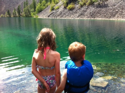 Sweet sibs share a moment at one of the most beautiful alpine lakes near Fernie.