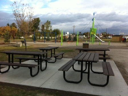 Our kids' new play park, complete with picnic tables, play equipment and a naturalization area intended to foster creative play.