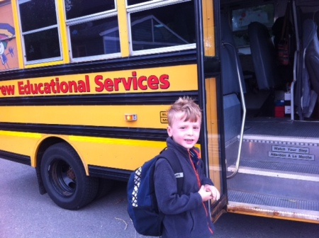 Bennett boards his bus all smiles on the first day of school.