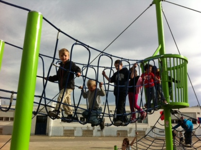 Bennett leads the troop across the rope bridge at the new playground.