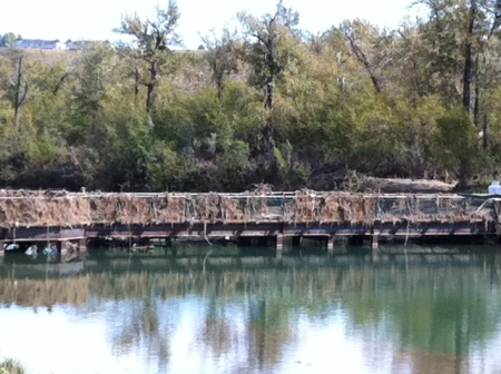 The large lods have been removed, but this bridge is still clogged with detritus.