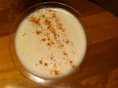 The nutmeg makes a pretty and fragrant garnish on a brandy flip.