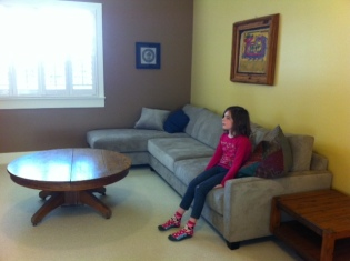 The kids LOVE having the basement back. Avery is enthralled with the new TV.