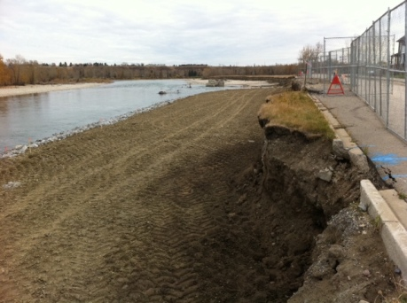 Crews reclaimed new bank with dirt, gravel and riprap.