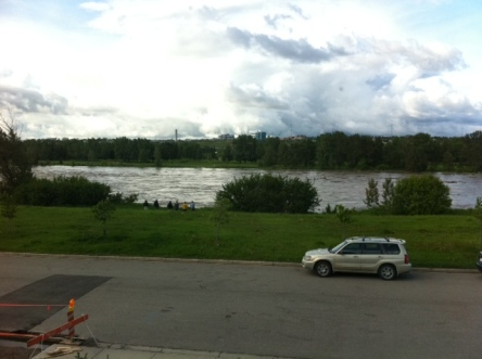 The view from our window on June 20, 2013. Lots of green space and trees along the river bank.