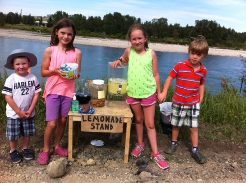 Selling lemonade, iced tea and cookies at a stand along the Bow River in Inglewood.