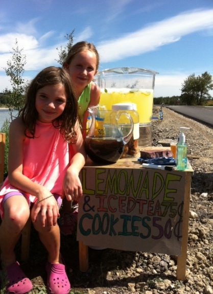 Avery and her friend sell .75-cent cups of lemonade and .50-cent cookies, on their way to a tidy profit.