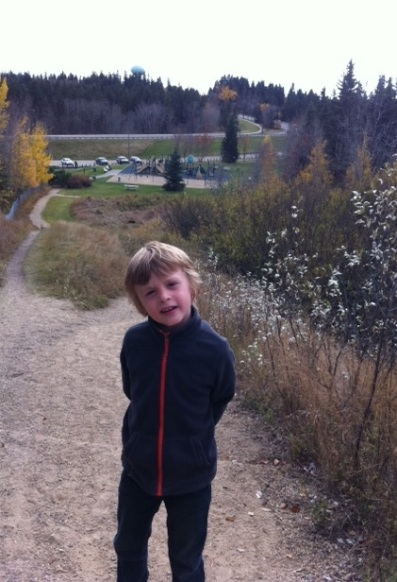 "Bennett loves climbing the hill at Rotary Park to see the ""mushroom"" (a green water tower) across the valley."