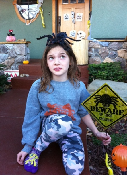Avery also bought a toxic creature to accompany the sign. It's on her head.