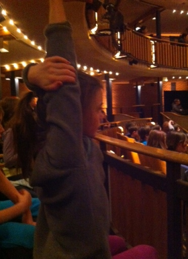 Avery strains to have her hand noticed during a Q&A session with the Charlotte's Web cast.