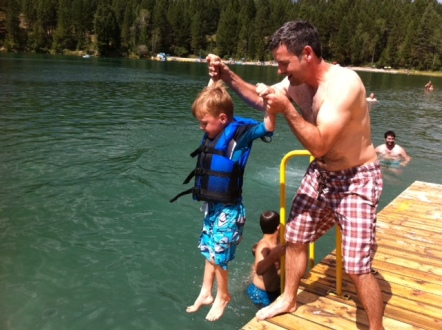 Blake lowers Bennett into Surveyor's Lake near Fernie in 2013.