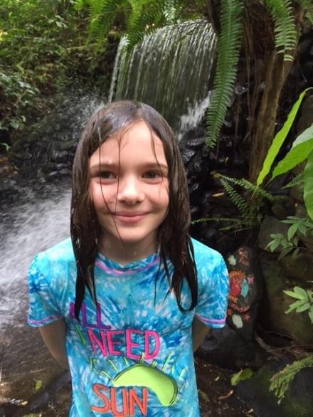 Avery enjoyed a soak in the waterfall at Villa Encantada. Photo by Lisa Kadane.