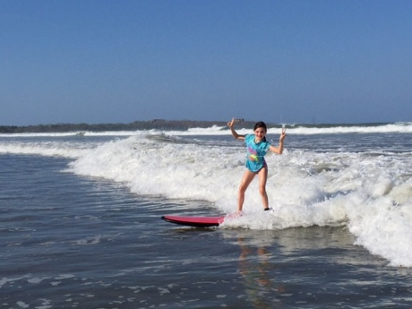 Avery is all confidence on her surf board, mugging for the camera.