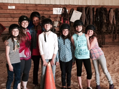 Future equestrians pose with their Girl Guide leader.