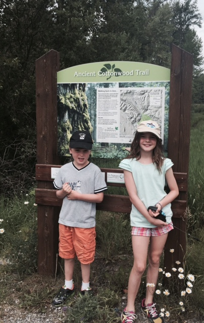 Bennett and Avery pose at the trailhead for the Ancient Cottonwood Trail near Fernie, B.C.