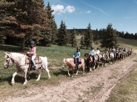 Girl Guides and some moms taken in the scenery on a sunny trail ride near Cochrane, Alta.