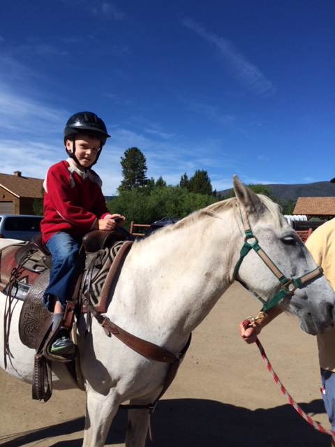 This is Bennett's second time horseback riding this summer. He's a natural, no?