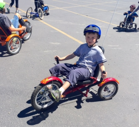 Bennett and other children with Chromosome 18 conditions try out a range of adapted bicycles on a field trip to the National Ability Centre.