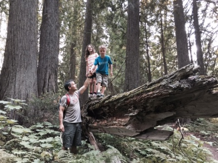 Balancing on a fallen tree… with a little help from Daddy.
