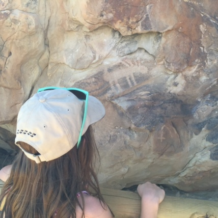 Avery spots a pictograph in Dinosaur National Monument.