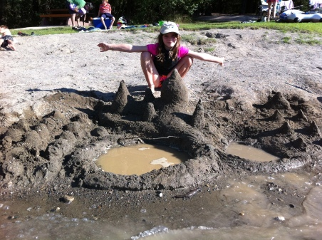 Tada! Avery demonstrates her sand castle-building abilities.