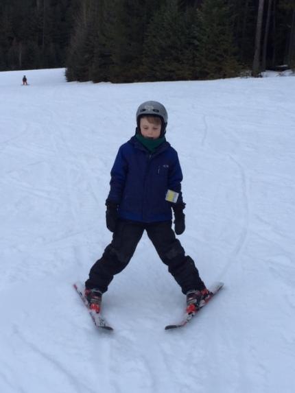 Bennett snowplows down a green run at Fernie Alpine Resort.