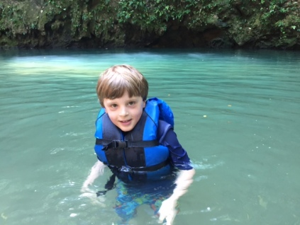 Bennett swims in a cenote (limestone sink hole filled with water) that's in a national park just a 15-minute walk from Caves Branch.