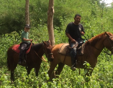 Bennett enjoys his first real trail ride in Belize.