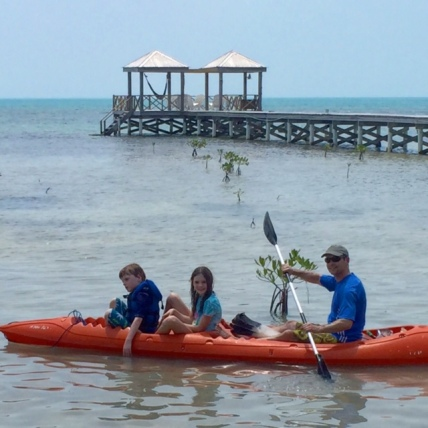 Bennett, Avery and Blake kayak off the dock on Ambergris Caye, Belize.
