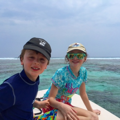 Bennett and Avery take a break from the sea on a snorkelling excursion to the Belize Barrier Reef.