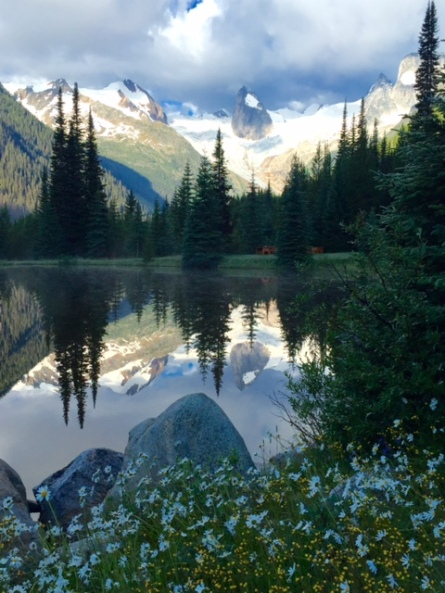 A quick stroll from CMH Bugaboos Lodge takes you to this small pond where the mountains are reflected in the still water.