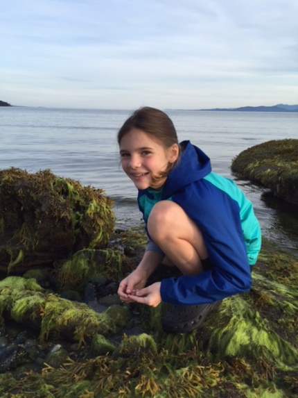 Avery is in her element looking for critters in a tide pool.