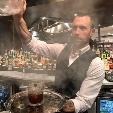 Bartender Austin Purvis reveals his Burnt Cherry Manhattan after a round of smoking at The Guild.